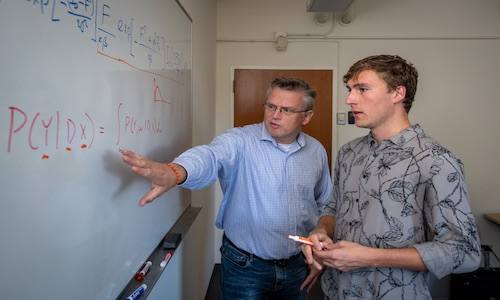 Undergrad Elliot Perryman (right) working with bioscientist Peter Zwar.